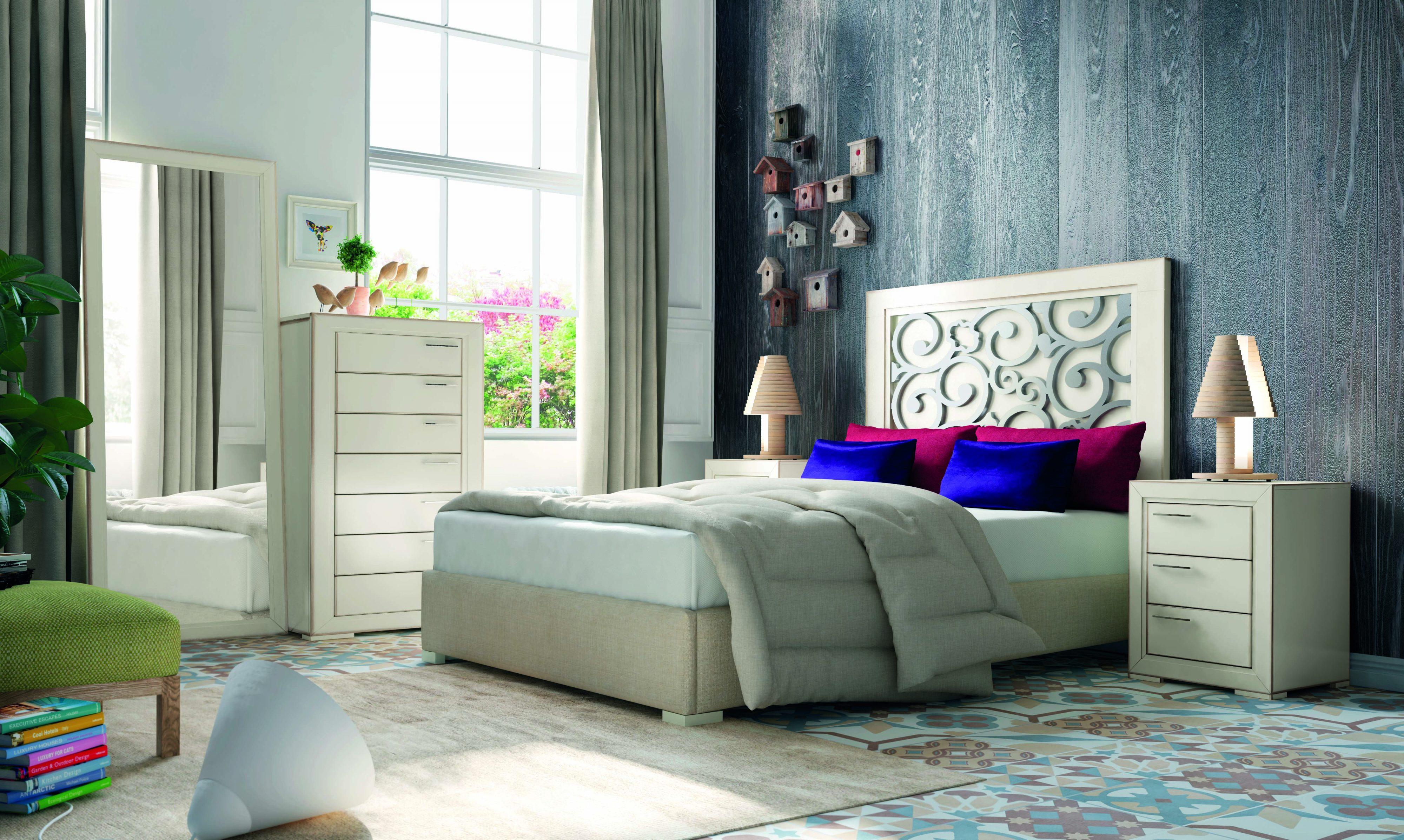 Dormitorio matrimonio en madera con cabecero estampado, para aquellos que buscan ambientes más elaborados.