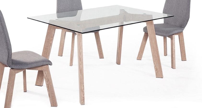 Mesa comedor fija 140x90, patas en cromo o imitación madera, cristal templado. Mesa comedor fija cristal 140x90 que muestra un estilo nórdico que aporta ese toque distintivo para crear ambientes sencillos y elegantes