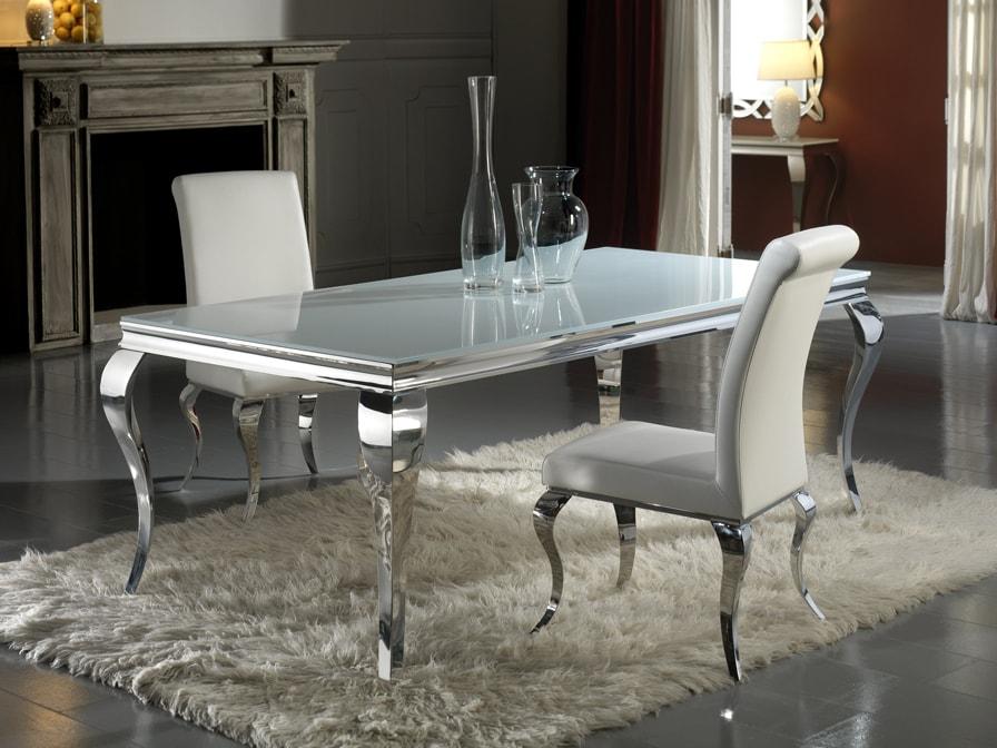 Mesa comedor 160 cm realizada en acero inoxidable y tapa cristal templado con canto pulido con sillas de la misma calidad tapizadas en ecopiel o tejido a elegir.